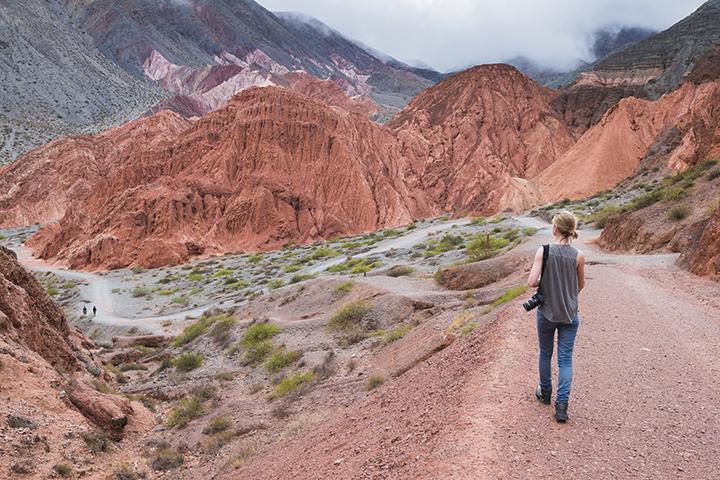 Woman on the trek around the Hill of Seven Colours (Cerro de los Siete Colores), Quebrada de Purmamarca, Jujuy Province, North Argentina