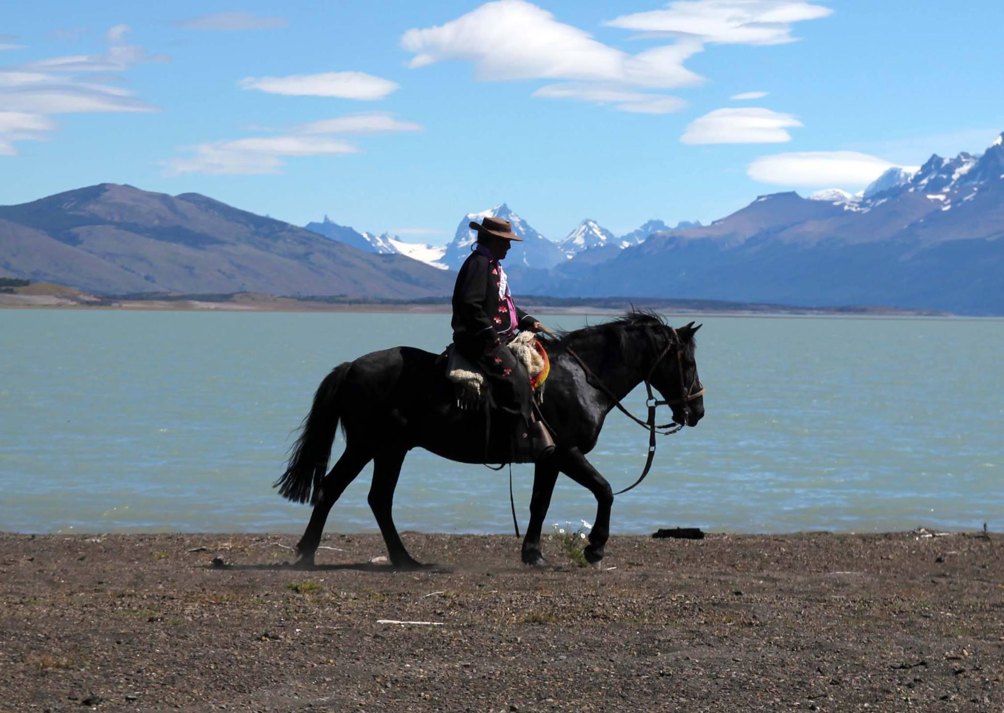 Gaucho riding at lake shore